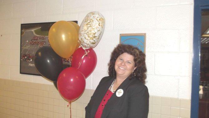 Principal Ann Gwynn celebrates her school history.