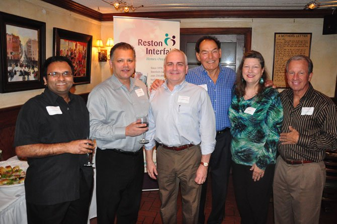 From left, Reston Smile Partners Members Sumit Sharma, Luis Martinez, Charles Fields, Frederick Dibbs, Joan Wise of Reston Interfaith and Joseph Richardson at a fundraiser at The Old Brogue Tuesday, May 1.