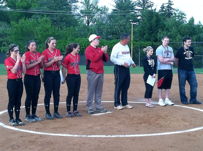 Earlier this season the Madison High girls' softball team held special 'Teacher's Night' festivities during pre-game ceremonies of the Warhawks' Liberty District home game versus Fairfax on April 20. Left to right, Madison High senior captains Janice Yahner, Jessica Darst, and Ally Grasso, along with freshman Allison Krisko, assist Madison Principal Mark Merrell (center) and head coach John Schneeberger (white, long sleeved shirt) in presenting the pre-game awards to the teachers.
