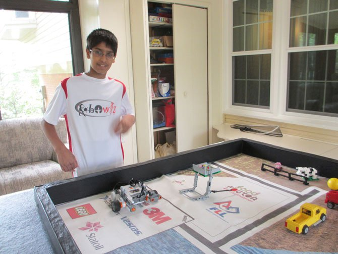 "Neeraj Prasa, Vienna, practices for the FIRST LEGO® League (FLL) competition, one in which young students design robotics and solve ""real-life"" challenges."
