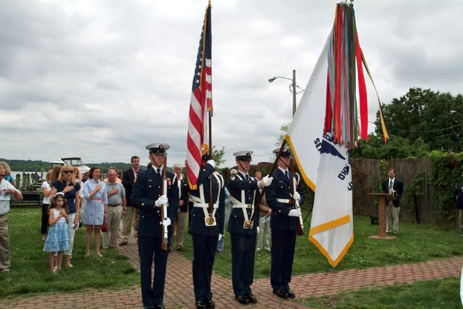 The U.S. Coast Guard Ceremonial Honor Guard presents the colors prior to the flag raising ceremony May 6 at the Old Dominion Boat Club.