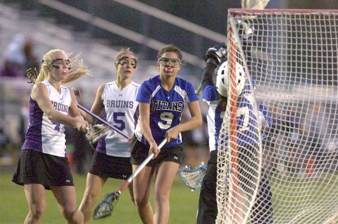 The Lake Braddock Secondary girls' lacrosse team, shown here in a Patriot District meeting versus T.C. Williams, is the No. 1-seed at the district tournament, which began last Friday and is continuing this week.