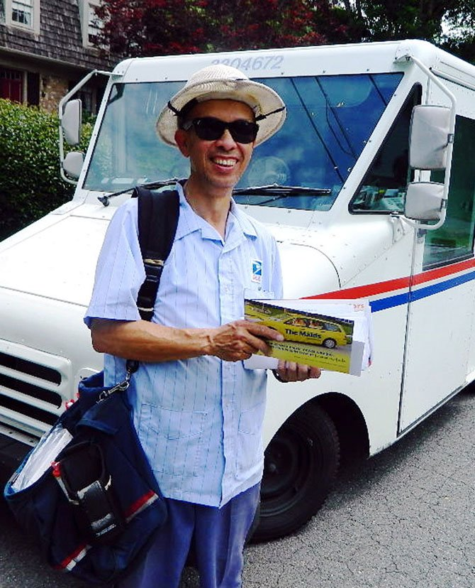 Postal carrier David Yip says he doesn't mind the extra work involved in collecting donated food.