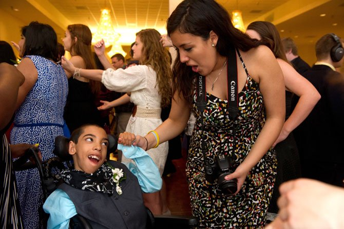Centreville High School student Faby Argandona dances with her peer and 'Best Buddy' Juwaan Espinal. This year, 179 students from eight schools participated in the three-and-a-half hour event. The Best Buddies program creates opportunities for students with intellectual and developmental disabilities to develop on-to-one friendships, integrated employment and leadership development by matching them up with student volunteers.