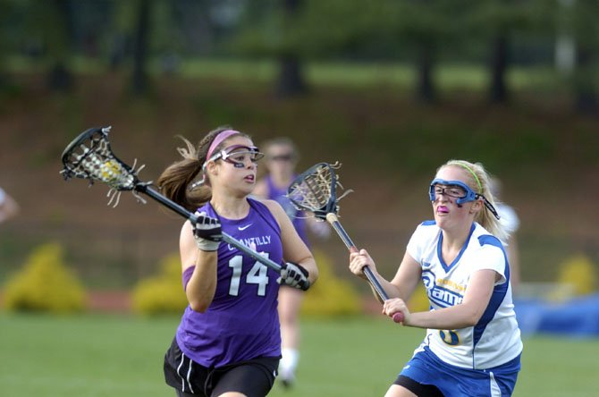 Chantilly High girls' lacrosse player Bridget Cleary looks to make a move with the ball during the Chargers' Concorde District quarterfinals playoff game at Robinson last Friday evening.