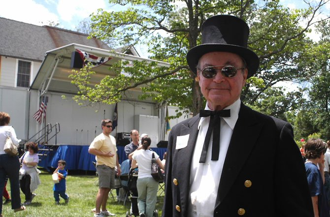 Tommy Lukas with his signature top hat and tails, greeted and entertained McLean Day participants on the McLean Day stage for 19 years.
