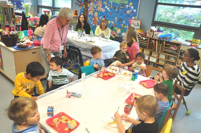 Jo Hicks, 89, watches a group of preschool students while volunteering at Franklin Sherman Elementary School. Hicks has volunteered for years for the schools preschool program. 