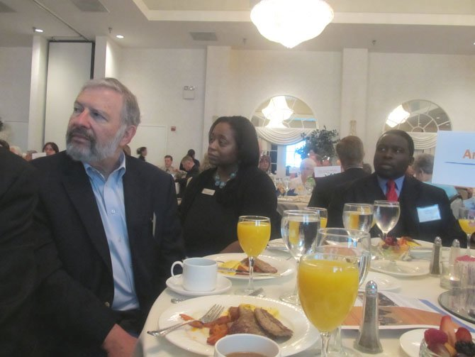 Amanda Andere, (center), FACETS executive director, listens with other guests during FACETS annual benefit breakfast at the Waterford in Fair Oaks Thursday, May 10.