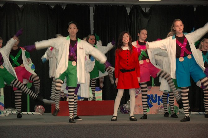 Veruca Salt, center, played by Holly Waters;  Oompa Loompas to her left and right: Taelor Oey and Maia Spoto.