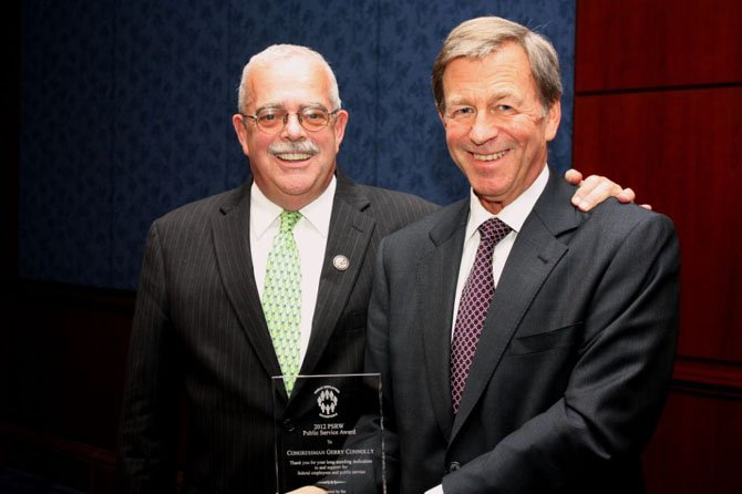 Congressman Gerry Connolly is presented with the 2012 Public Service Award by William Bransford, vice chair of the Public Employees Roundtable, at a ceremony in the U.S. Capitol.