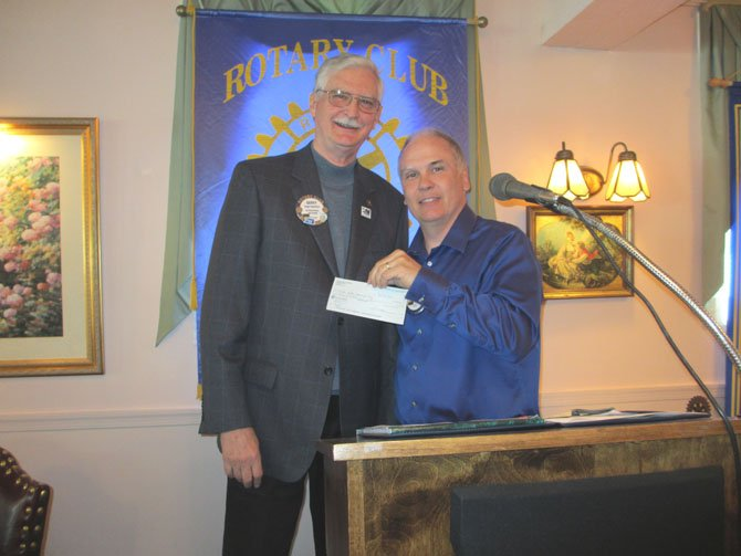 Tom Kyllo accepts a check on behalf of the Khristin Kyllo Memorial Fund from the Vienna Rotary Club on May 9.