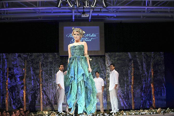 Show Opener: Green evening gown with pleats designed by Jenny Ong, Fashion Design &#39;12, and modeled by Gabriela Skura.