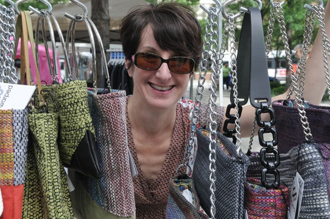 Warped owner Jennifer David and a selection of her custom handbags.
