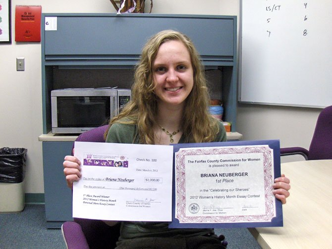 Chantilly senior Briana Neuberger shows her first-place award and replica of her scholarship check.