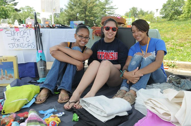 T.C. Williams students Shavonni Dickens, Dale Hacker and Latavia Taylor set up a booth for the junior class. At the conclusion of the sale, all unsold items were donated to the Salvation Army.