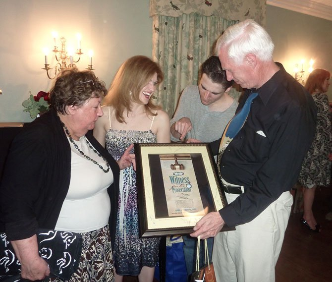 "Director Eddie Page, right, is presented with an autographed cast poster by Cheryl Sinsabaugh, Robin Zerbie and Russell Silber at the wrap party for LTA's ""Witness for the Prosecution"" May 12."