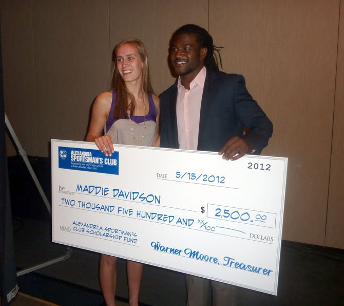 SSSA senior Maddie Davidson poses with her scholarship check with Redskins running back Tim Hightower following the ASC awards dinner May 15 at the Westin Carlyle Hotel.