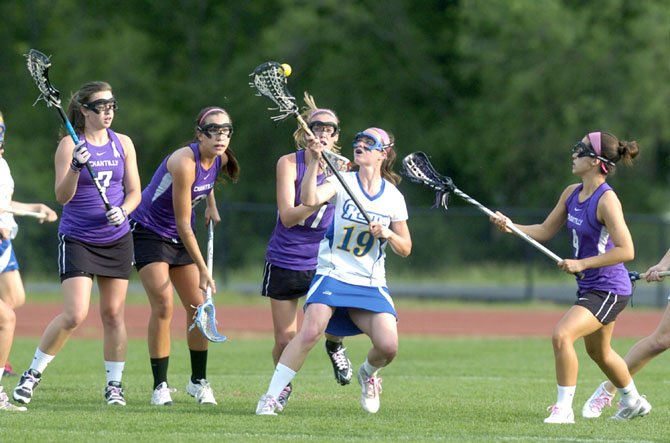 Robinson's Megan Barlow is surrounded by Chantilly High Chargers in recent Concorde District playoff action.