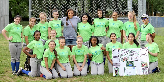 The Lee High girls' softball team gathered for a photo at the benefit game on May 7. The team's players designed special game shirts for the contest, which honored former Robinson head coach Barry Gorodnick, who passed away on Saturday, May 12. Dorian Shaw (top row, middle), a former Northern Virginia softball star, was a special guest at the tribute game.