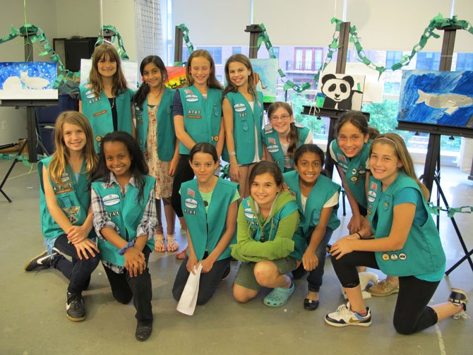 Troop #4741, a fifth-grade Junior troop from Bells Mill Elementary School, earned its Bronze Award by raising awareness of endangered species at an Art Night at VisArts in Rockville on Monday, May 7. The Bronze Award is the highest award given to junior troops. The girls worked together for two months to select their project, learn about different animals on the endangered species list, and create an original work of art and an informational paper on endangered animals. The girls presented their work at an ArtNight planned and run by the girls. The girls targeted adults for their outreach efforts as they believe that fewer adults are aware of or care about endangered animals.