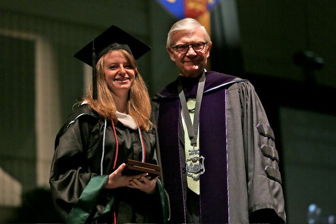 Rebecca Koenig, from Springfield, was the recent recipient of the 2012 Lord Botetourt Medal at William & Mary's Commencement on Sunday, May 13. President Taylor Reveley presented Koening with the award.