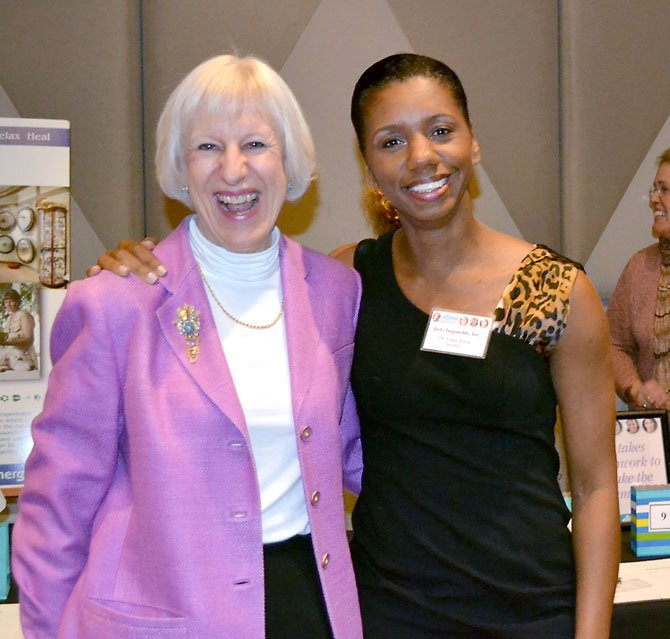 Dr. Venus Opal Reese  (with Carol Plummer, left) encourages women to realize their full potential at a luncheon at Lakewood Country Club in North Potomac.
