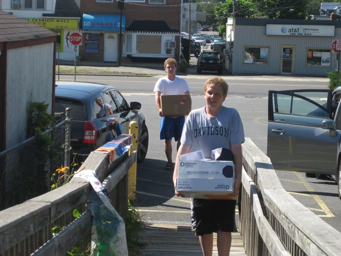 David Luftglass and Nick Stuban delivering food to the ACCA food pantry.