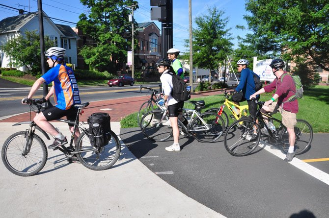 Cyclists wait to cross Elden Street during Bike to Work Day Friday, May 18. 