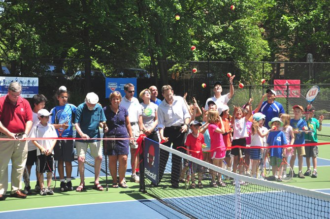 Reston officials, residents and children cut the ribbon on the new under 10 children's tennis courts Saturday, May 19. Six courts were created out of two previously existing full sized ones.