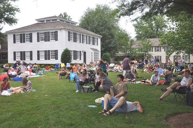 The crowd at the Great Falls Village Green takes in the one of the annual Concerts on the Green, which will kick off Sunday, June 3.