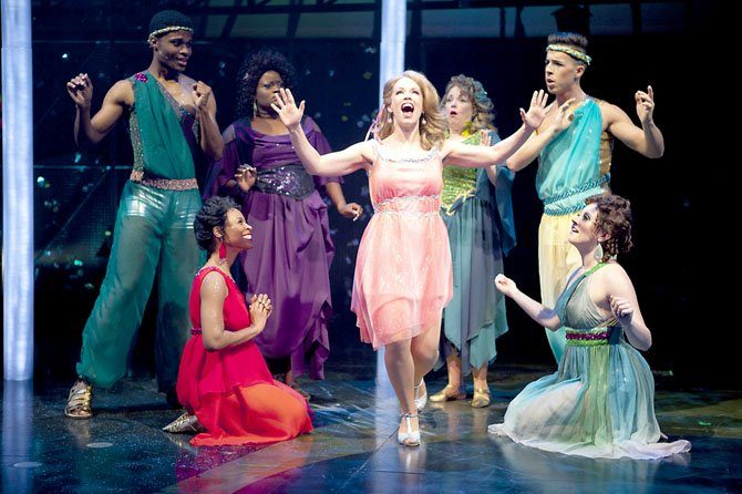 "Erin Weaver (center, as Kira) with her Greek Muses (from left to right) Nickolas Vaughan, Kellee Knighten Hough, Nova Y. Payton, Sherri L. Edelen, Mark Chandler, and Jamie Eacker. ""Xanadu"" plays at Virginia's Signature Theatre through July 1."