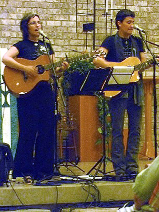 Sandy O and Pat Humphries of Emma's Revolution perform at the Unitarian Universalist Church of Arlington.