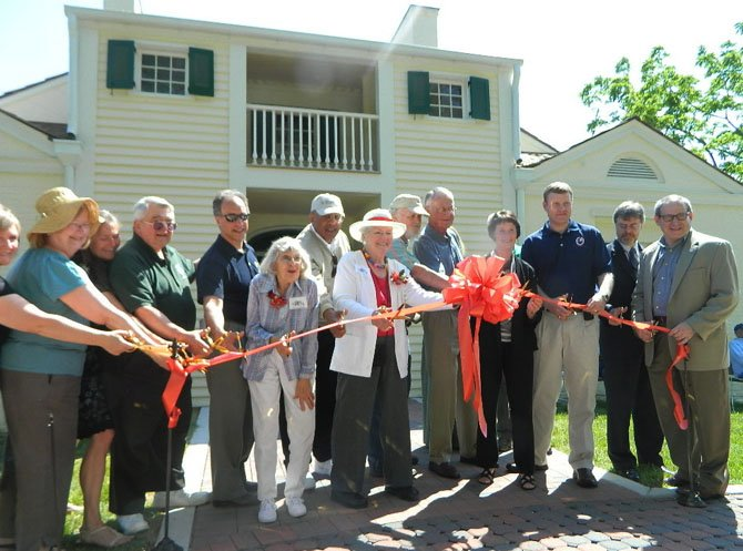 The ribbon-cutting, led by Barbara Ballentine and Board of Supervisors Chairman Sharon Bulova, took place in the back of the house where the ground is level.