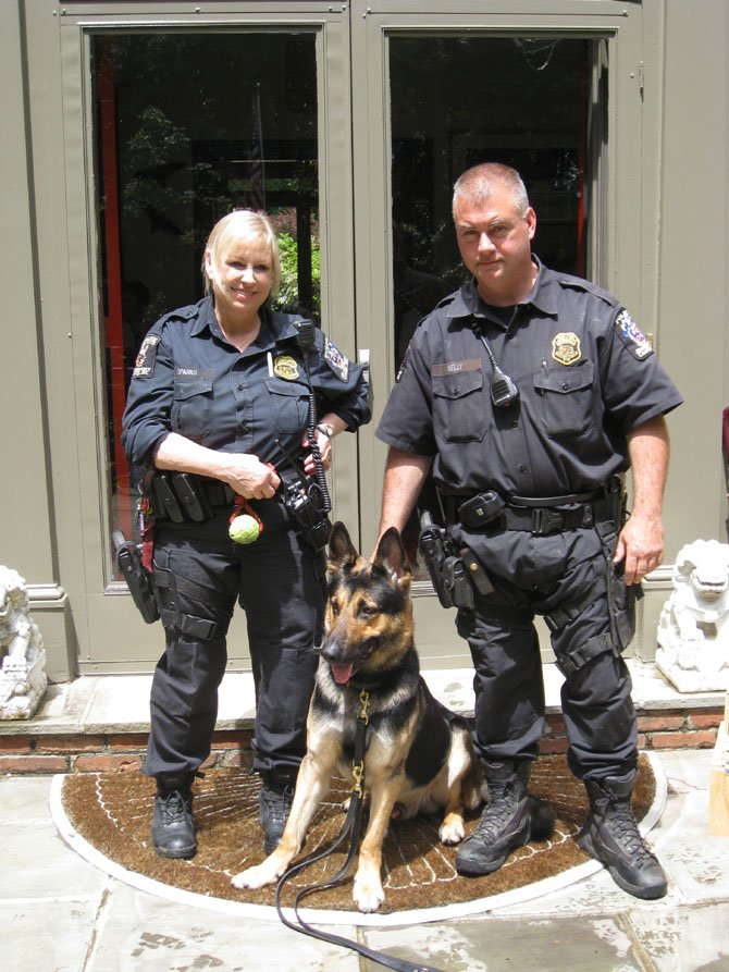 Montgomery County Police Officer Sharon Sparks and Officer Tom Kelly with K-9 colleague, Ben