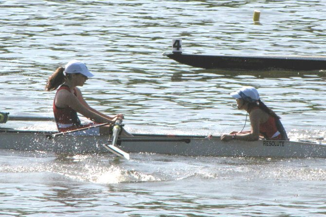 Coxswain Kathrina Policarpio shouts out commands to rower Maeve Bradley as she and other members of the T.C. Williams girls' freshman 8 race toward the finish line during their semifinal heat at the Stotesbury Cup Regatta on the Schuylkill River in Philadelphia on May 19. The freshman girls placed second in their heat to advance to the final of the event.