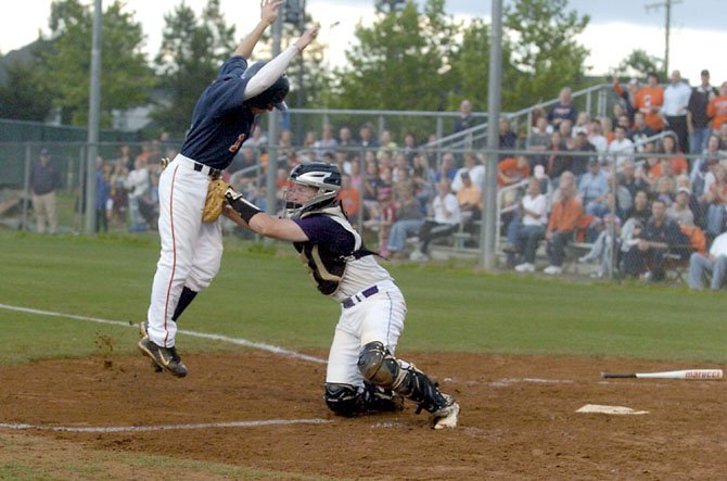 Lake Braddock catcher Garett Driscoll tags out West Springfield's Taylor Boyd during the third inning of the Patriot District championship game on May 21.