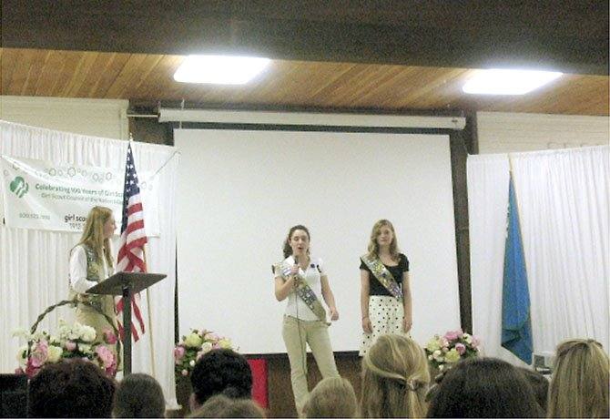 Master of Ceremony Katelyn Moore, 16, of Burke honors silver award recipients Allison Howl, 17, and Claire Schindler, 17, both of Springfield.