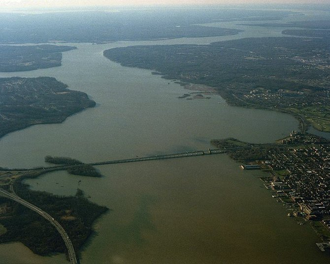 A view of the Potomac River as it flows past Alexandria, Virginia towards its outlet at the Chesapeake Bay.