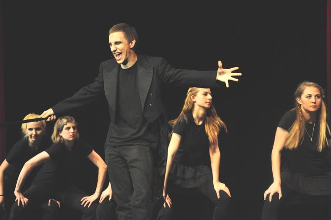 "Max Johnson leads a performance of ""Willkommen"" from ""Cabaret"" at McLean High School's concert Friday, May 25, which featured a variety of songs from Tony Award-winning musicals."