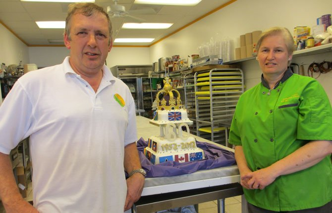 The Pure Pasty Co. owner Mike Burgess and chef Nicola Willis-Jones with the Queen Elizabeth II Diamond Jubilee fruitcake Willis-Jones and fellow Pure Pasty chefs created.