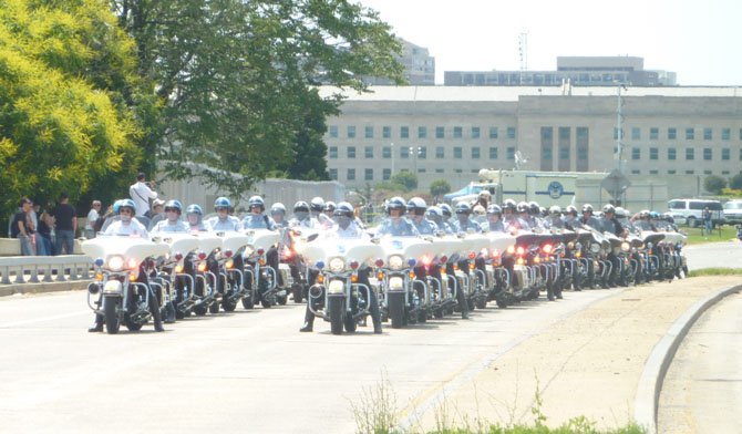 Motorcycle police officers from around the region line up just moments before leading the start of Rolling Thunder 2012.