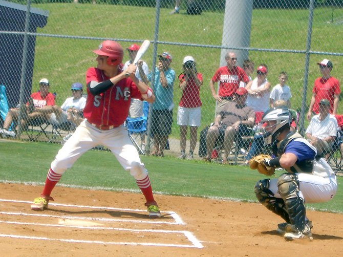 McLean Highs Joey Sullivan (batting) made a key late game defensive play and also hit a game-tying double for the Highlanders in their extra innings region playoff game loss at Lake Braddock on Memorial Day. 