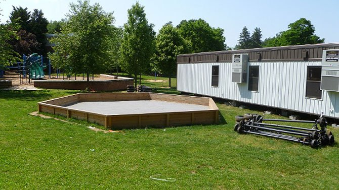 The trailers are located in between the playground and the baseball field in front of the Jamestown Elementary School.