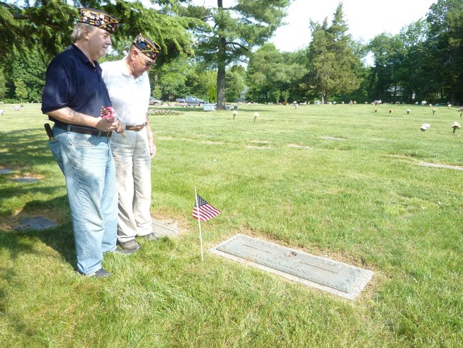 Veterans Jim Glassman and Warden Foley pay their respects at the grave of Thomas Mickler, a fellow veteran and former commander of American Legion Post 24.