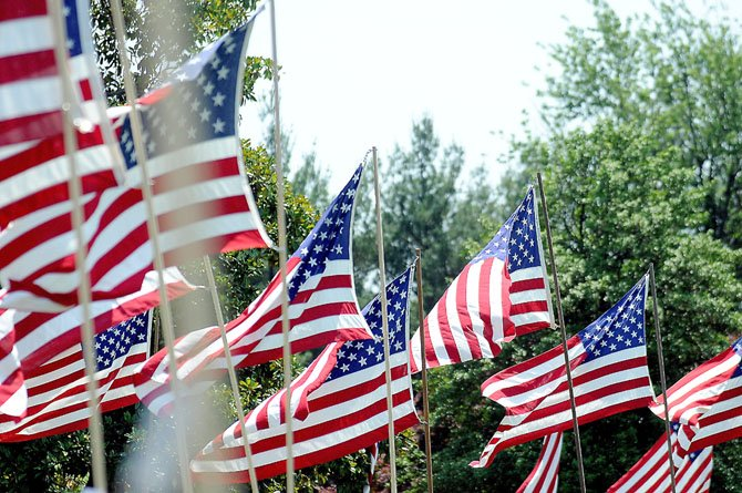 More than 400 American flags lined the roadways in the Mount Comfort Cemetery in honor and in memory of the veterans for the 33rd Annual Giovanna McKinney Memorial Avenue of Flags.