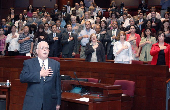 Rep. Gerry Connolly (D-11) leads 75 new U.S. citizens from 33 countries in Pledge of Allegiance at Fridays naturalization ceremony at the Fairfax County Government Center.  In his remarks, Connolly told the newly-minted citizens &quot;you are as American as I am.&quot;