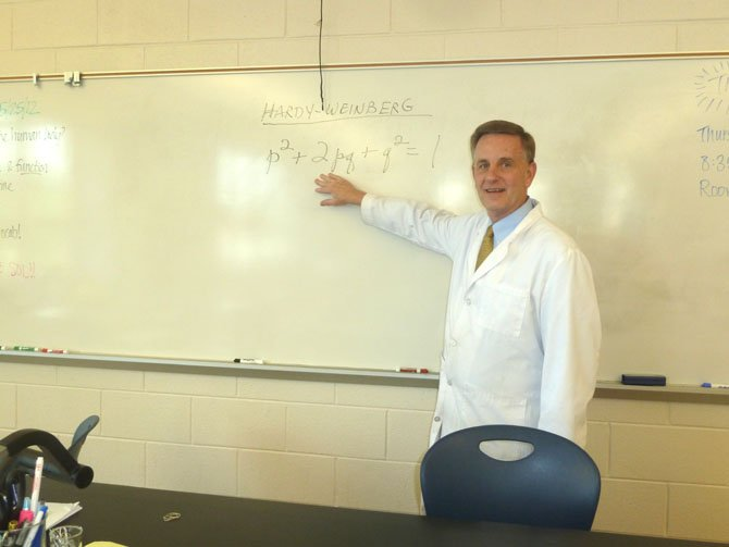 Biology teacher David Keener prepares notes on evolution for his fourth period class.
