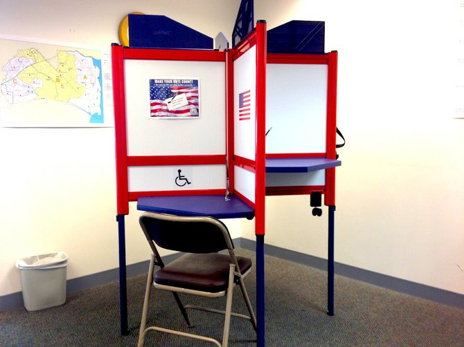 New voting booths on display at the registrar's office.
