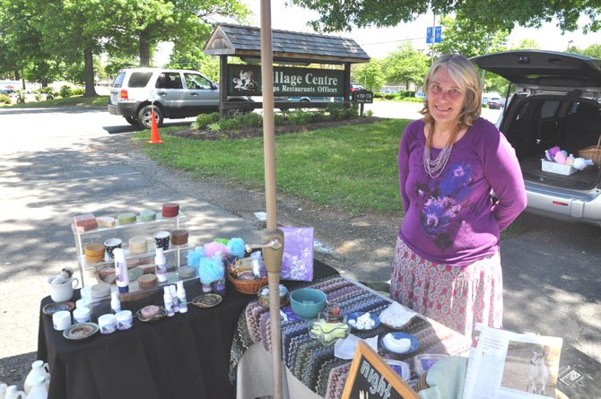 Jennifer Downey of Night Sky Farms, one of the many vendors at the Great Falls Farmers Market. Downey specializes in dairy products, cheeses as well as body soaps, lotions and other cleaning products.