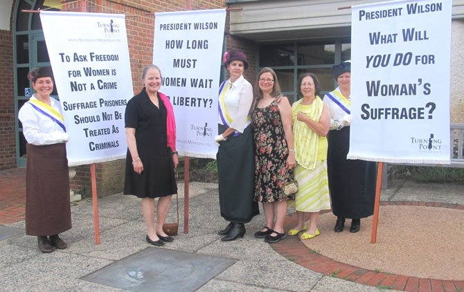 Standing Up for Women's Rights – Anne Stuntz, president of Historic Vienna, Inc.; Leigh Kitcher, treasurer of Historic Vienna, Inc.; and Paula Elsey stand with the Silent Sentinels reenacting a picket at the 2012 Turning Point Suffragist Memorial award ceremony held at Meadowlark Botanical Gardens in Vienna on Wednesday, May 30.
